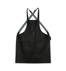A SUSPENDER SERIE apron made of 100% leather, with adjustable suspenders made of elastic